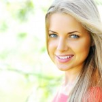Closeup of happy cheerful smiling young beautiful blond woman, o