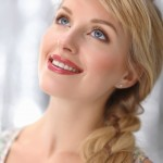 Beautiful blonde young woman with braid hairdo
