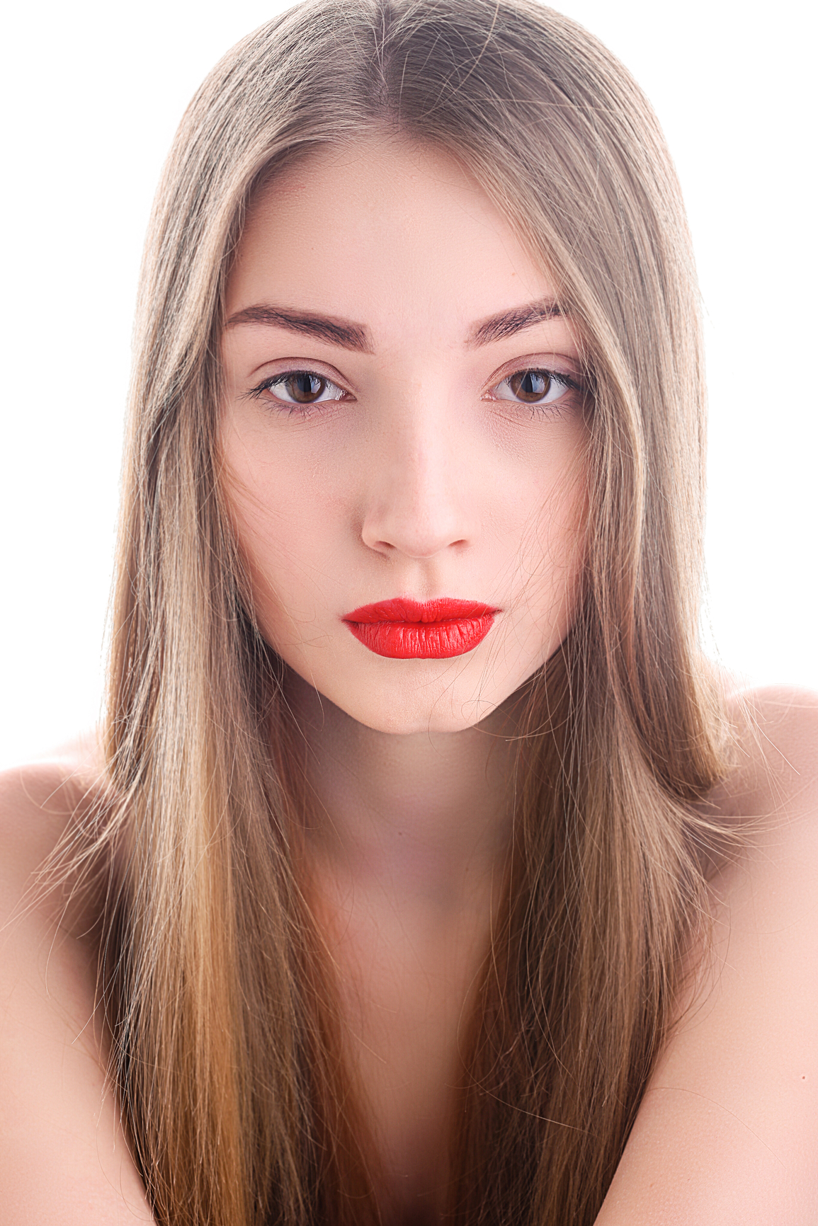 Portrait of attractive young woman with red lipstick